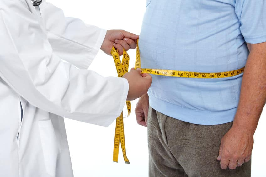 46630142 - Doctor Measuring Obese Man Waist Body Fat. Obesity And Weight Loss.